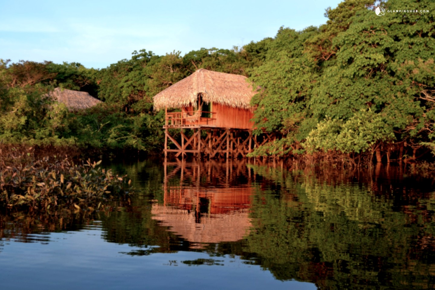 Photo of Bungalow Lodges Overlooking River in Amazon Rainforest near Manaus, Brazil