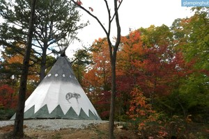 Hand-Painted Native American Tipis for Camping on Indiana Ranch