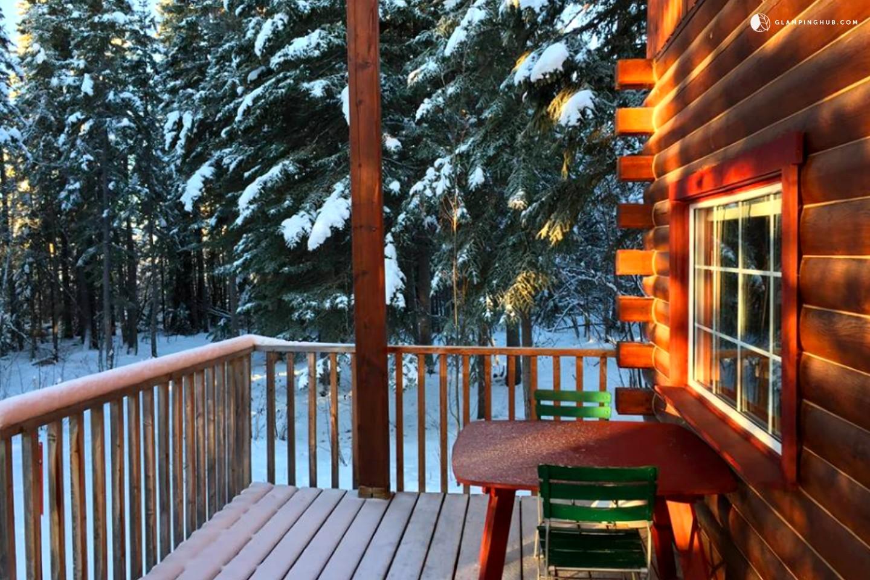 Log Cabin Near A Mountain Lake Yukon Canada. Full resolution  snapshot, nominally Width 1440 Height 960 pixels, snapshot with #BE3B0D.
