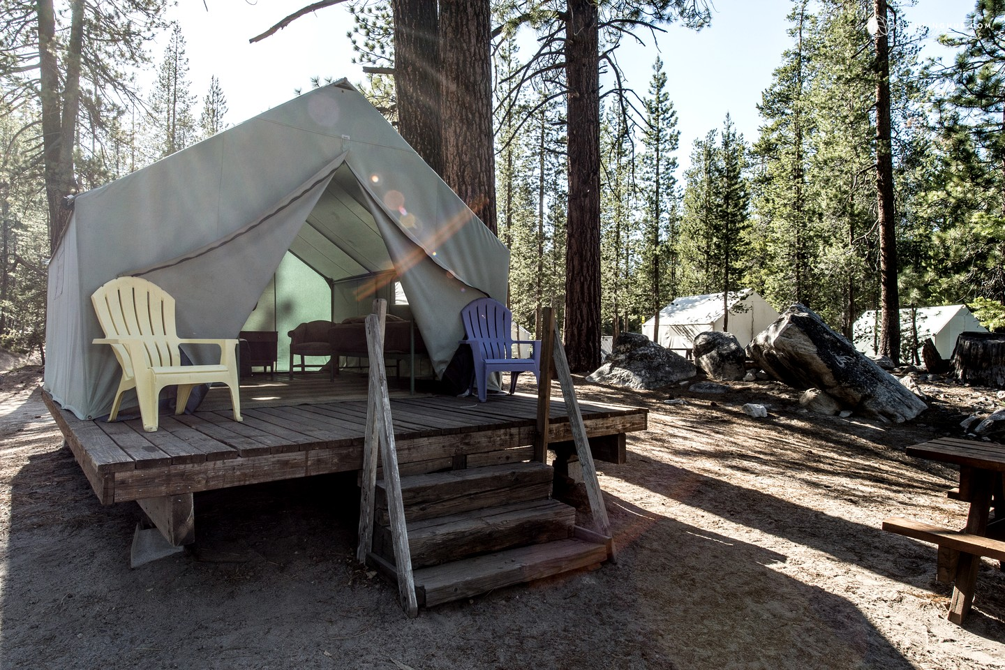 Stunning tent cabins near shoreline of lake in high sierra for Tent cottage