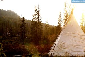 Traditional Tipi Below the Renowned Rocky Mountains in Colorado